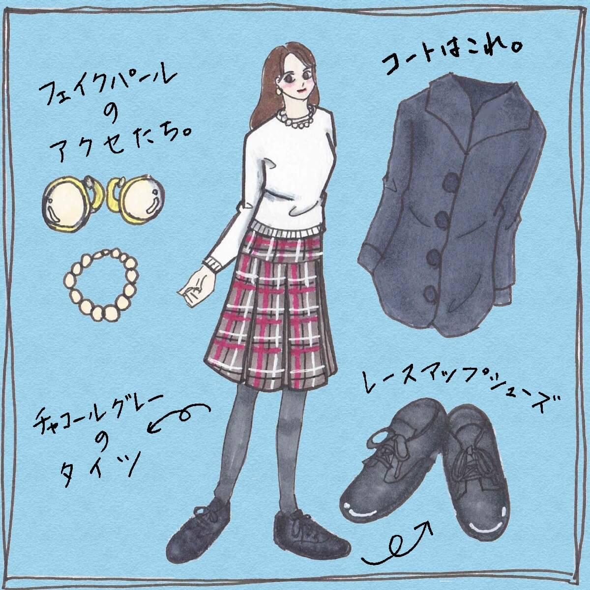 ホワイトのニットとチェック柄スカートのコーディネート
